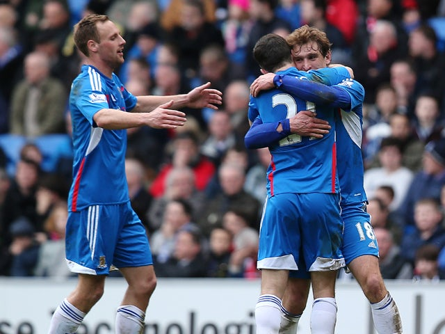 Nikica Jelavic of Hull celebrates with team mates after scoring the team's second goal during the Barclays Premier League match between Cardiff City and Hull City at Cardiff City Stadium on Febuary 22, 2014