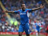 Tom Huddlestone of Hull celebrates after scoring the first goal of the game during the Barclays Premier League match between Cardiff City and Hull City at Cardiff City Stadium on Febuary 22, 2014