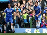 Frank Lampard of Chelsea celebrates with John Terry as he scores their first goal during the Barclays Premier League match between Chelsea and Everton at Stamford Bridge on February 22, 2014