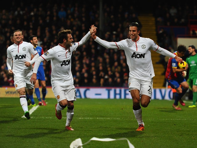 Robin Van Persie of Man United celebrates with Juan Mata after scoring from the spot during the Barclays Premier League match between Crystal Palace and Manchester United at Selhurst Park on February 22, 2014