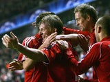 Dirk Kuyt celebrates his goal against Inter Milan with his Liverpool teammates on February 19, 2008.