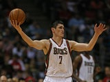 Ersan Ilyasova #7 of the Milwaukee Bucks chases down a loose ball against the Miami Heat in Game Four of the Eastern Conference Quarterfinals during the 2013 NBA Playoffs at the Bradley Center on April 28, 2013