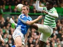 Frazer Wright of St Johnstone competes with Victor Wanyama of Celtic during the Clydesdale Bank Scottish Premier League match between Celtic and St Johnstone at Celtic Park Stadium on May 11, 2013