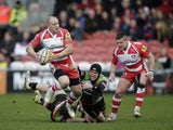Mike Tindall of Gloucester is tackled during the Aviva Premiership match between Gloucester and Harlequins at the Kingsholm Stadium on February 22, 2014