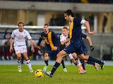 Luca Toni of Hellas Verona scores his team's openig goal from the penalty spot during the Serie A match between Hellas Verona FC and Torino FC at Stadio Marc'Antonio Bentegodi on February 17, 2014