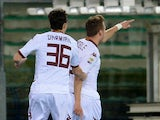 Ciro Immobile of Torino FC celebrates after scoring his team's first goal during the Serie A match between Hellas Verona FC and Torino FC at Stadio Marc'Antonio Bentegodi on February 17, 2014