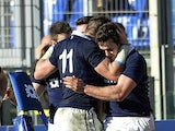 Scotland's Alex Dunbar celebrates with teammates after scoring a try during the Six Nations International rugby union match between Italy and Scotland on February 22, 2014