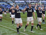 Scotland's players celebrate after winning the Six Nations International rugby union match between Italy and Scotland on February 22, 2014