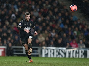 McArthur rescues late point for Wigan
