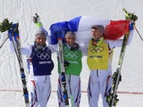 Silver Medallist, France's Arnaud Bovolenta; Gold Medallist, France's Jean Frederic Chapuis; and Bronze Medallist, France's Jonathan Midol celebrate at the Men's Freestyle Skiing cross on February 20, 2014