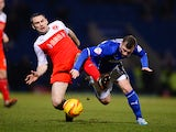Jimmy Ryan of Chesterfield is tackled by Alan Goodall of Fleetwood Town during the Johnstone's Paint Northern Area Final match at Proact Stadium on February 18, 2014