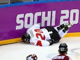 John Tavares #20 of Canada crashes into the boards during the Men's Ice Hockey Quarterfinal Playoff against Latvia during the 2014 Sochi Winter Olympics on February 19, 2014