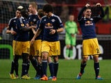Salzburg's Jonathan Soriano celebrates with teammates after scoring his team's third goal against Ajax during their Europa League match on February 20, 2014