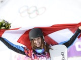 Gold Medallist, Austria's Julia Dujmovits celebrates at the Women's Snowboard Parallel Slalom Flower Ceremony at the Rosa Khutor Extreme Park during the Sochi Winter Olympics on February 22, 2014