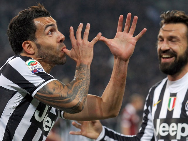 Juventus' Argentine forward Carlos Tevez celebrates after scoring during the Italian Serie A football match between Juventus and Torino on February 23, 2014