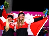 Kaillie Humphries and Heather Moyse of Canada team 1 celebrate after winning the gold medal during the Women's Bobsleigh on Day 12 of the Sochi 2014 Winter Olympics at Sliding Center Sanki on February 19, 2014
