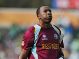 West Indies' Kieron Pollard walks off the pitch after being caught out by Pakistan's Kamran Akmal during the 2013 ICC Champions Trophy cricket match between Pakistan and West Indies at The Oval cricket ground in London on June 7, 2013