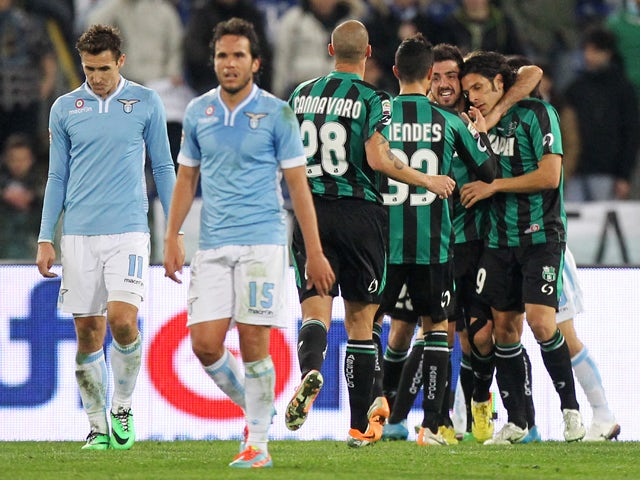 Sergio Floccari of of US Sassuolo Calcio celebrates with his team-mates after scoring the team's first goal during the Serie A match between SS Lazio and US Sassuolo Calcio at Stadio Olimpico on February 23, 2014