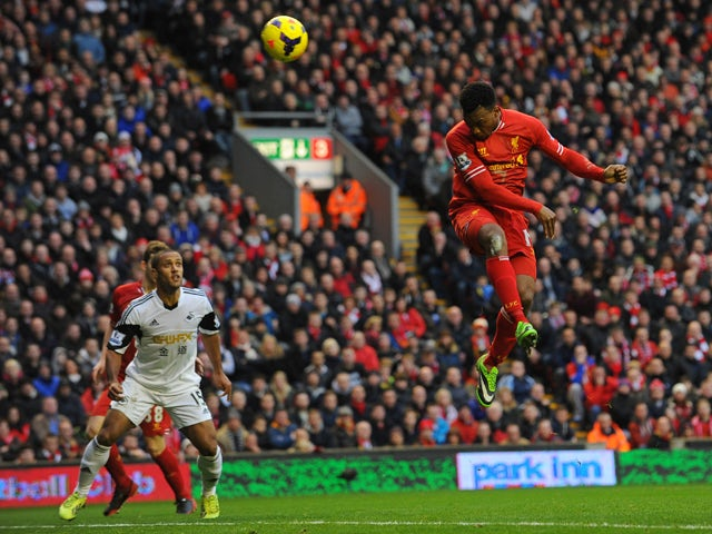 Liverpool's English striker Daniel Sturridge heads to score his team's third goal during the English Premier League football match between Liverpool and Swansea City at Anfield in Liverpool, northwest England on February 23, 2014