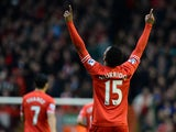 Liverpool's English striker Daniel Sturridge celebrates scoring the opening goal during the English Premier League football match between Liverpool and Swansea City at Anfield in Liverpool, northwest England on February 23, 2014