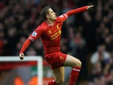 Jordan Henderson of Liverpool celebrates scoring the second goal during the Barclays Premier League match between Liverpool and Swansea City at Anfield on February 23, 2014