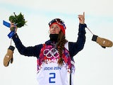 Maddie Bowman of the United States celebrates receiving her gold medal for the Freestyle Skiing Ladies' Ski Halfpipe Finals during the 2014 Winter Olympics on February 20, 2014