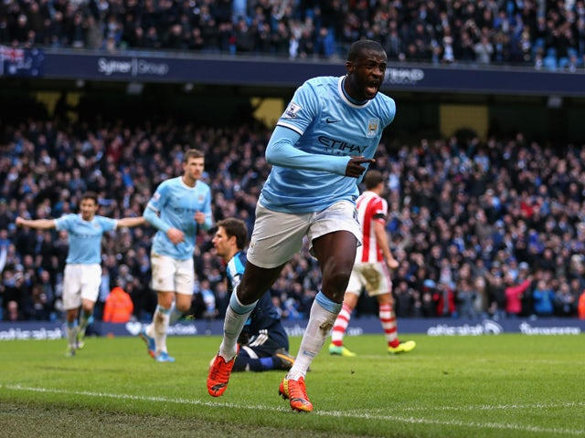 Yaya Toure of Manchester City celebrates scoring the opening goal during the Barclays Premier League match between Manchester City and Stoke City at the Etihad Stadium on February 22, 2014