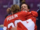 Marie-Philip Poulin #29 and Shannon Szabados #1 of Canada celebrate after Poulin's game winning goal in overtime against the United States during the Ice Hockey Women's Gold Medal Game on day 13 of the Sochi 2014 Winter Olympics at Bolshoy Ice Dome on Feb