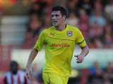 Mark Hudson of Cardiff in action during the pre-season match between Brentford an Cardiff at Griffin Park on July 30, 2013