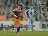 Montpellier's French midfielder Anthony Mounier reacts after scoring a goal during the French L1 football match Montpellier (MHSC) vs AC Ajaccio on February 22, 2014