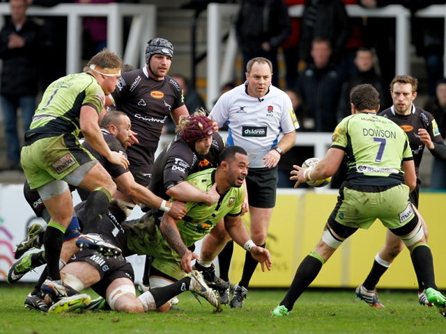 Salesi Ma'afu of Northampton saints releases the ball to Phil Dowson during the Aviva Premiership match between Newcastle Falcons and Northampton at Kingston Park on February 23, 2014