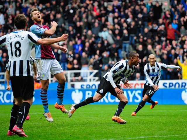 Newcastle player Loic Remy celebrates after scoring the winning goal during the Barclays Premier League match between Newcastle United and Aston Villa at St James' Park on February 23, 2014