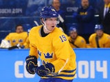 Nicklas Backstrom #19 of Sweden skates against Latvia during the Men's Ice Hockey Preliminary Round Group C game on day eight of the Sochi 2014 Winter Olympics at Shayba Arena on February 15, 2014