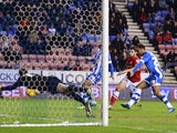 Nicky Maynard of Wigan scores to make it 1-0 during the Sky Bet Championship match between Wigan Athletic and Barnsley at the DW Stadium on February 18, 2014
