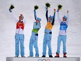 Norway's Magnus Hovdal Moan, Haavard Klemetsen, Magnus Krog and Joergen Graabak celebrate their gold medal on the podium at the Nordic Combined Team LH / 4x5 km Flower Ceremony at the RusSki Gorki Jumping Center during the Sochi Winter Olympics on Februar
