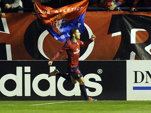Osasuna's midfielder Alvaro Cejudo celebrates a goal during the Spanish league football match Osasuna vs Atletico de Madrid at El Sadar stadium in Pamplona on February 23, 2014