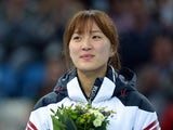 South Korea's gold medalist Park Seung-Hi poses during the Women's Short Track 1000 m Flower Ceremony at the Iceberg Skating Palace during the Sochi Winter Olympics on February 21, 2014
