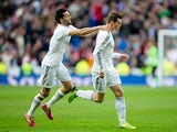 Gareth Bale of Real Madrid CF celebrates scoring their second goal with teammate Alvaro Arbeloa during the La Liga match between Real Madrid CF and Elche CF at Estadio Santiago Bernabeu on February 22, 2014
