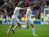 Gareth Bale of Real Madrid CF celebrates scoring their second goal with teammate Alvaro Arbeloa during the La Liga match between Real Madrid CF and Elche CF at Estadio Santiago Bernabeu on February 22, 2014
