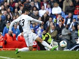 Real Madrid's midfielder Isco kicks to score during the Spanish league football match Real Madrid vs Elche at the Santiago Bernabeu stadium in Madrid on February 22, 2014