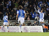 Real Sociedad's French forward Antoine Griezmann celebrates after scoring during the Spanish league football match Real Sociedad vs FC Barcelona at the Anoeta stadium in San Sebastian on February 22, 2014