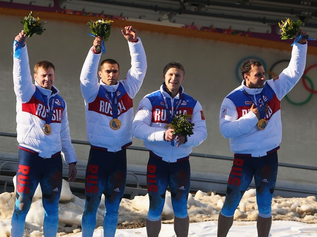 Gold medalists Russia team 1 celebrate on the podium during the medal ceremony for the Four-Man Bobsleigh on Day 16 of the Sochi 2014 Winter Olympics at Sliding Center Sanki on February 23, 2014