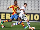 Valencia's Seydou Keita and Dynamo Keiv's Oleh Husyev in action during their Europa League match on February 20, 2014