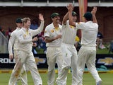 Australia team celebrates the wicket of South Africa's batsman Quinton de Kock during the second test match between South Africa and Australia at St George's Park, in Port Elizabeth on February 20, 2014