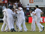 South Africa's cricketers celebrate their win over Australia in the second test match between South Africa and Australia at St George's Park in Port Elizabeth on February 23, 2014