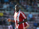 Toumani Diagouraga of Brentford in action during the Sky Bet League One match between Coventry City and Brentford at Sixfields Stadium on September 29, 2013