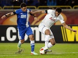 Dnipro's Victor Giuliano and Tottenham's Etienne Capoue in action during their Europa League match on February 20, 2014