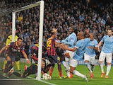 Barcelona's goalkeeper Victor Valdes makes a save near his line during the UEFA Champions League Last 16, first leg football match against Manchester City on February 18, 2014