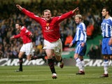 Wayne Rooney scores against Wigan Athletic in the League Cup final on February 26, 2006.