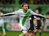 Wolfsburg's Dutch striker Bas Dost celebrates during the German first division Bundesliga football match VfL Wolfsburg vs Bayer Leverkusen on February 22, 2014